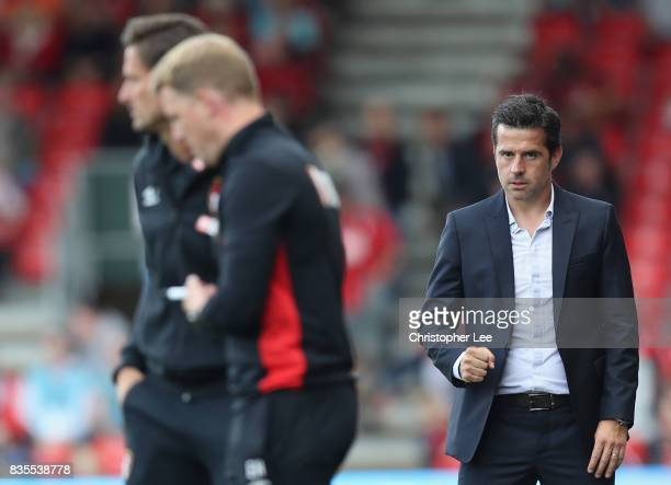 Marco Silva Manager of Watford celebrates their victory as he looks towards Eddie Howe Manager of AFC Bournemouth during the Premier League match...