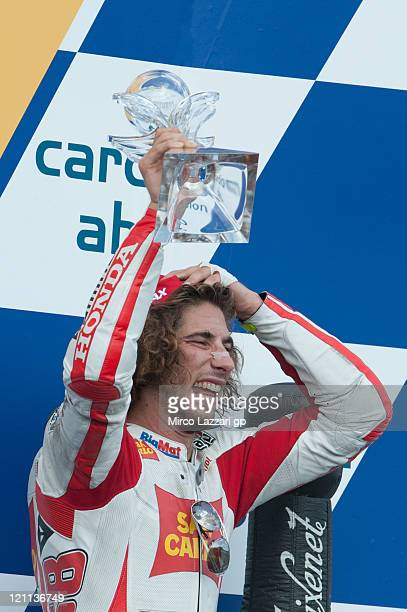 Marco Simoncelli of Italy and San Carlo Honda Gresini celebrates coming 3rd at the end of the MotoGP race of MotoGp of Czech Republic at Brno Circuit...