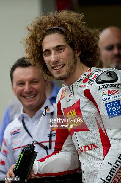 Marco Simoncelli of Italy and San Carlo Honda Gresini celebrates at the end of the qualifying practice during the MotoGP of Italy at Mugello Circuit...