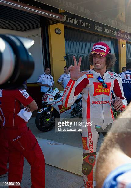 Marco Simoncelli of Italy and San Carlo Honda Gresini celebrates the third place at the end of the qualifying practice of MotoGP of Valencia at...