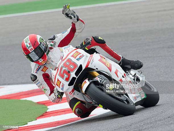 Marco Simoncelli of Italy and San Carlo Honda Gresini greets the fans at the end of the MotoGP race of the MotoGP of San Marino at Misano World...