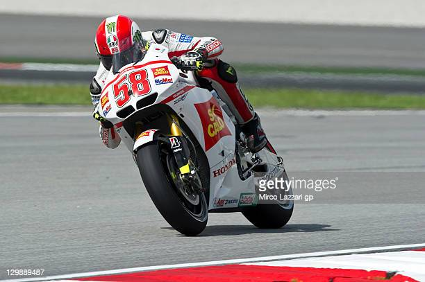 Marco Simoncelli of Italy and San Carlo Honda Gresini heads down a straight during the free practice for the MotoGP of Malaysia at Sepang Circuit on...