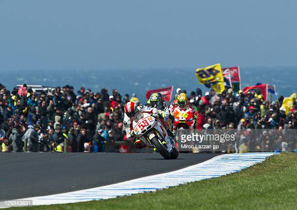 Marco Simoncelli of Italy and San Carlo Honda Gresini leads Valentino Rossi of Italy and Ducati Marlboro Team during the MotoGP race of the...
