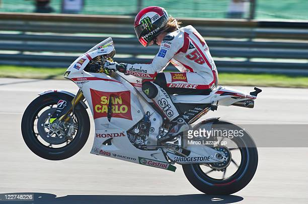Marco Simoncelli of Italy and San Carlo Honda Gresini lifts the front wheel during the MotoGP race of the Red Bull Indianapolis GP at Indianapolis...