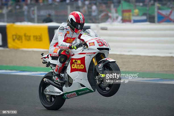 Marco Simoncelli of Italy and San Carlo Honda Gresini lifts the front wheel at the end of the MotoGP race at Circuito de Jerez on May 2 2010 in Jerez...