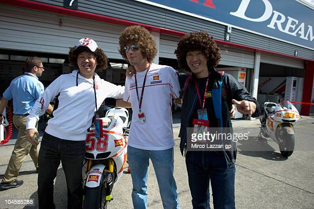 Marco Simoncelli of Italy and San Carlo Honda Gresini pose with fans during the pit walk of MotoGP of Japan at Twin Ring Motegi on October 1 2010 in...