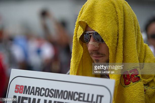 Marco Simoncelli of Italy and San Carlo Honda Gresini prepares to start on the grid of the MotoGP race of MotoGP of Malaysia at Sepang Circuit on...