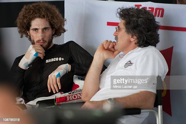 Marco Simoncelli of Italy and San Carlo Honda Gresini relax in box with his father Paolo during the third day of testing at Sepang Circuit on...