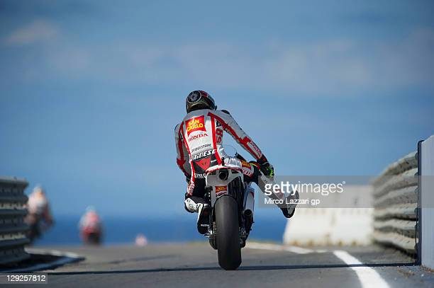 Marco Simoncelli of Italy and San Carlo Honda Gresini starts from the pit during the qualifying practice for the Australian MotoGP which is round 16...