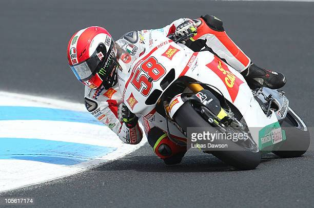 Marco Simoncelli of Italy rides the San Carlo Honda Gresini Honda during warm up at the Australian MotoGP which is round 16 of the MotoGP World...