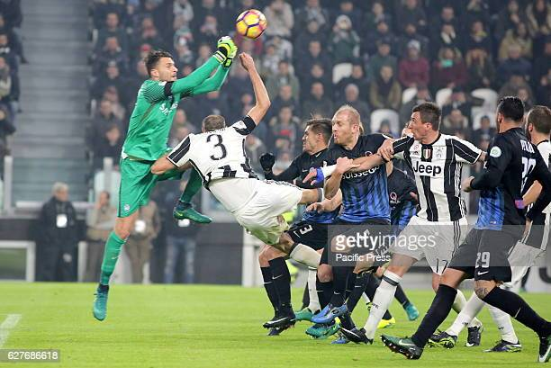 Marco Sportiello of Atalanta and Giorgio Chiellini of Juventus compete for the ball during the Serie A football match between Juventus FC and...