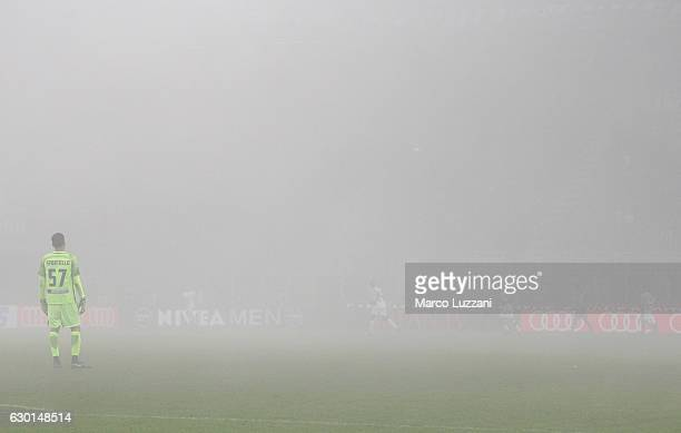 Marco Sportiello of Atalanta BC watches the action through fog during the Serie A match between AC Milan and Atalanta BC at Stadio Giuseppe Meazza on...
