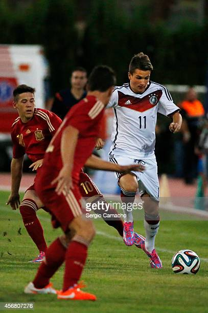 Marco Stefandl of Germany runs with the ball during the international friendly match between U17 Spain and U17 Germany at Campo Municipal de Nerja on...
