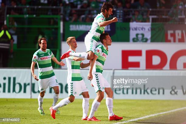 Marco Stiepermann of Greuther Fuerth celebrates his team's first goal with team mates Marco Caligiuri Johannes Wurtz and Stephan Fuerstner during the...