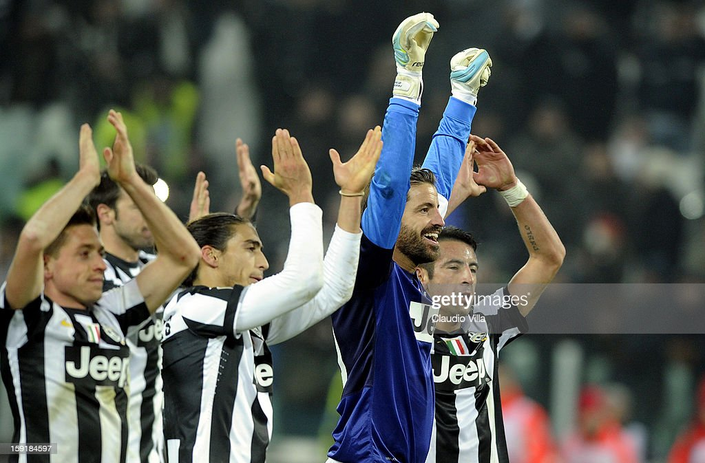 <a gi-track='captionPersonalityLinkClicked' href=/galleries/search?phrase=Marco+Storari&family=editorial&specificpeople=2144477 ng-click='$event.stopPropagation()'>Marco Storari</a> of Juventus FC (C) celebrates victory at the end the TIM cup match between Juventus FC and AC Milan at Juventus Arena on January 9, 2013 in Turin, Italy.