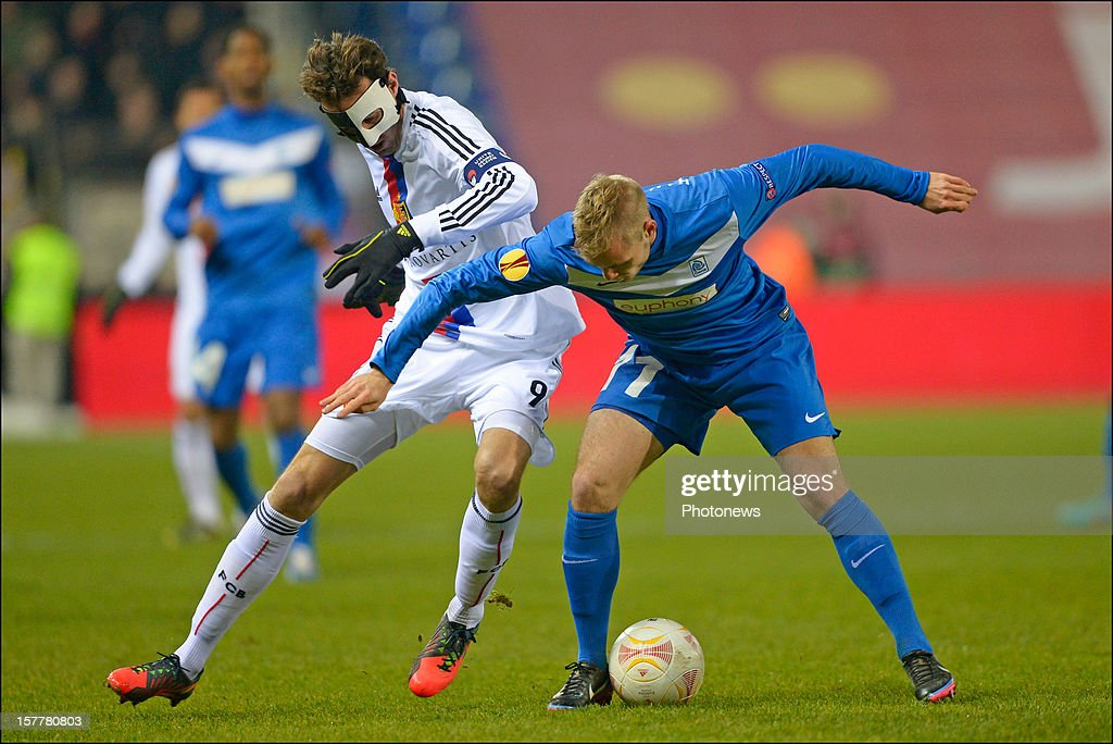 Marco Streller of FC Basel 1893 battles for the ball with Brian Hamalainen of KRC Genk during the UEFA Europa League group G match between KRC Genk and FC Basel 1893 at the Cristal Arena stadium on December 06, 2012 in Genk, Belgium.