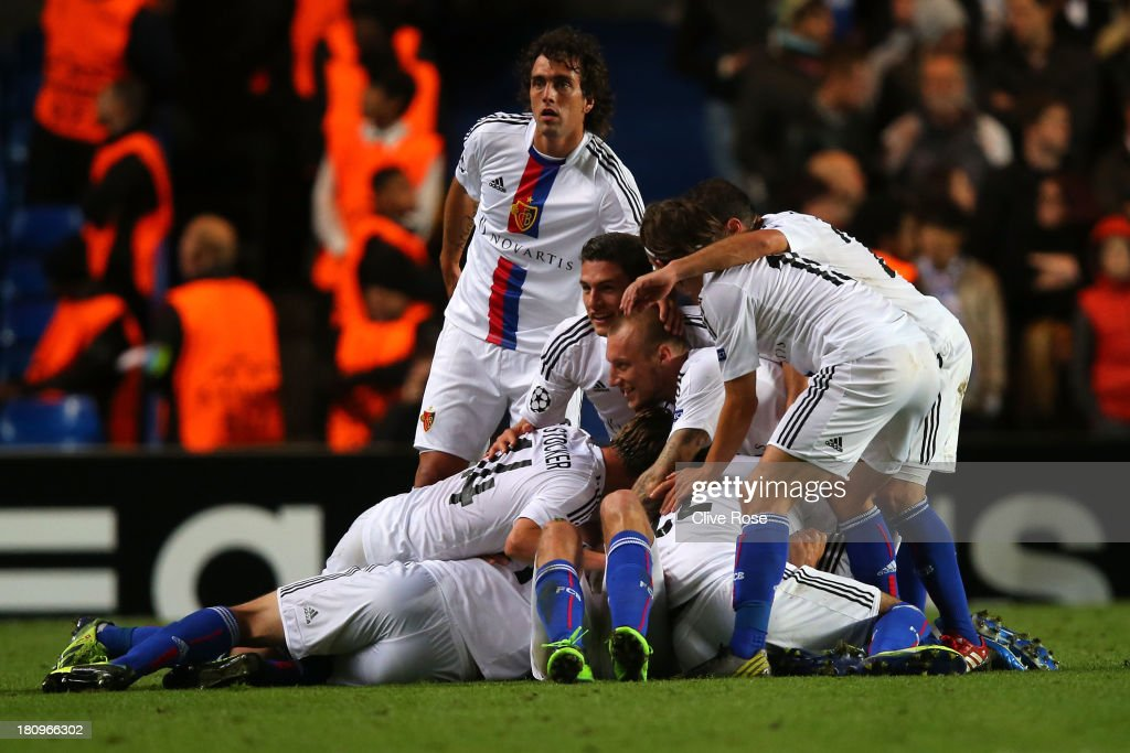 <a gi-track='captionPersonalityLinkClicked' href=/galleries/search?phrase=Marco+Streller&family=editorial&specificpeople=534494 ng-click='$event.stopPropagation()'>Marco Streller</a> of FC Basel celebrates scoring their second goal with team mates during the UEFA Champions League Group E Match between Chelsea and FC Basel at Stamford Bridge on September 18, 2013 in London, England.