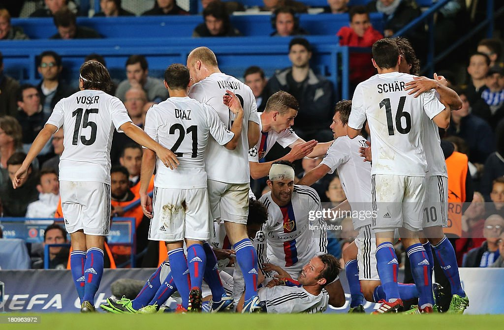 <a gi-track='captionPersonalityLinkClicked' href=/galleries/search?phrase=Marco+Streller&family=editorial&specificpeople=534494 ng-click='$event.stopPropagation()'>Marco Streller</a> of FC Basel celebrates with team mates after scoring their second goal during the UEFA Champions League Group E Match between Chelsea and FC Basel at Stamford Bridge on September 18, 2013 in London, England.