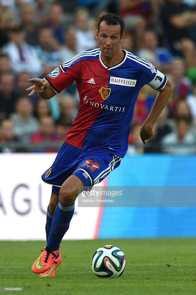 <a gi-track='captionPersonalityLinkClicked' href=/galleries/search?phrase=Marco+Streller&family=editorial&specificpeople=534494 ng-click='$event.stopPropagation()'>Marco Streller</a> of FC Basel in action during the Raiffeisen Super League match between FC Basel and FC Zurich at St. Jakob-Park on August 9, 2014 in Basel, Switzerland.