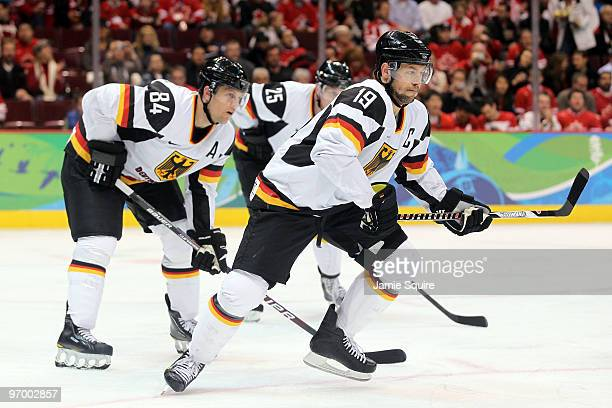 Marco Sturm and Dennis Seidenberg of Germany skate during the ice hockey Men's Qualification Playoff game between Germany and Canada on day 12 of the...