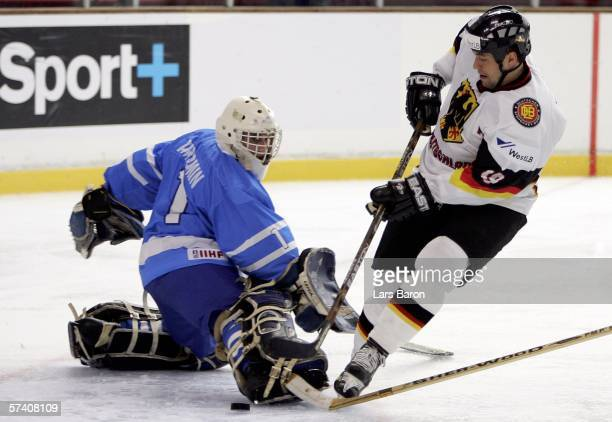 Marco Sturm of Germany scores a goal against goalie Boris Amromin of Israel during the IIHF World Championship Division 1 Group A match between...