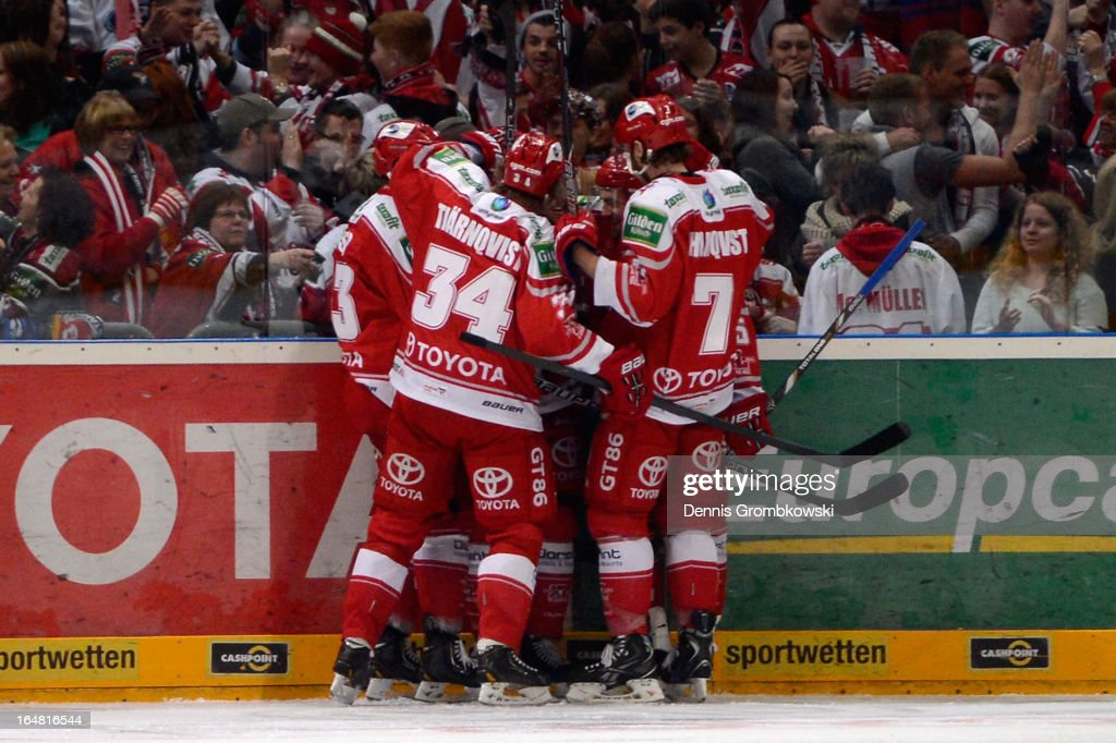 <a gi-track='captionPersonalityLinkClicked' href=/galleries/search?phrase=Marco+Sturm&family=editorial&specificpeople=211377 ng-click='$event.stopPropagation()'>Marco Sturm</a> of Koeln celebrates with teammates after scoring first goal in game five of the DEL play-offs between Koelner Haie and Straubing Tigers at Lanxess Arena on February 28, 2013 in Cologne, Germany.