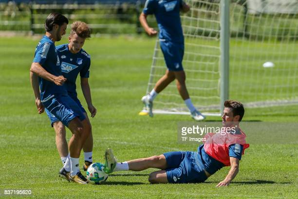 Marco Terrazzino of Hoffenheim Robin Hack of Hoffenheim and Havard Nordtveit of Hoffenheim battle for the ball during the Training Camp of TSG 1899...