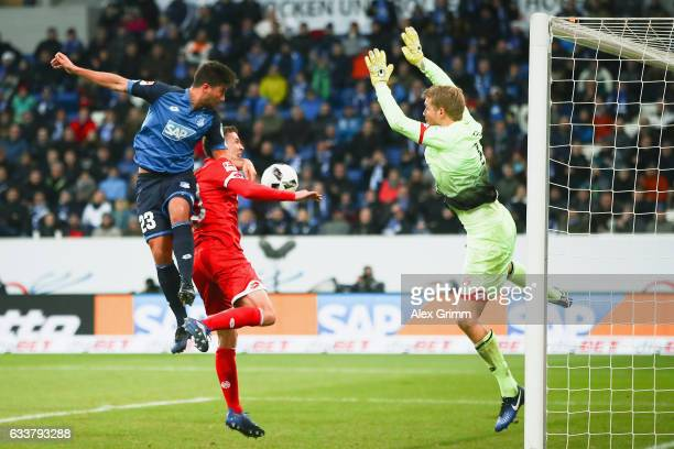 Marco Terrazzino of Hoffenheim scores his team's second goal past Fabian Frei and goalkeeper Jonas Loessl of Mainz during the Bundesliga match...