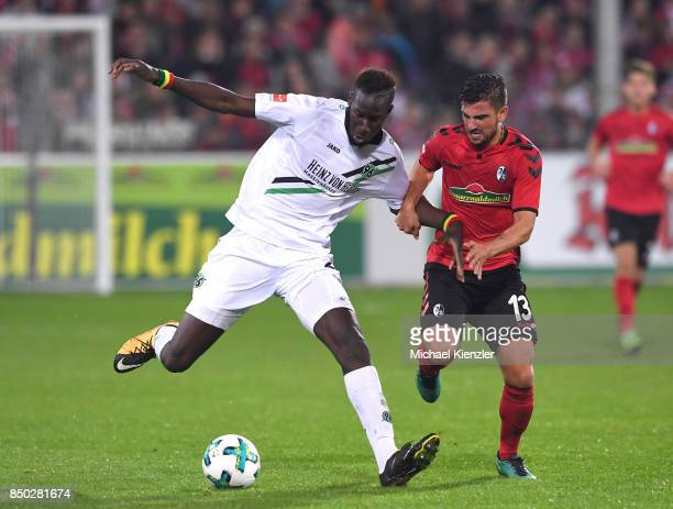 Marco Terrazzino of SC Freiburg challenges Salif Sane of Hannover 96 during the Bundesliga match between Sport Club Freiburg and Hannover 96 at...