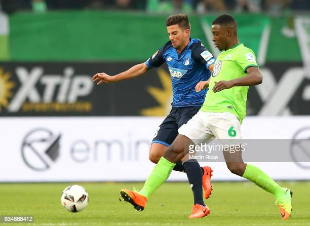 Marco Terrazzino of Wolfsburg is challanged by Riechedly Bazoer of Wolfsburg during the Bundesliga match between VfL Wolfsburg and TSG 1899...