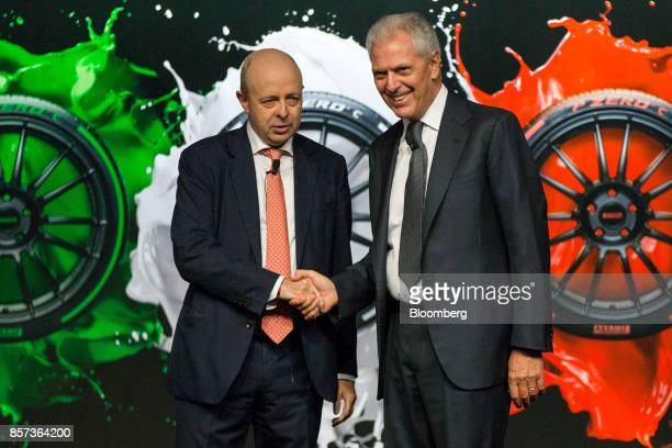 Marco Tronchetti Provera chief executive officer of Pirelli C SpA right shakes hands with Raffaele Jerusalmi chief executive officer of Borsa...