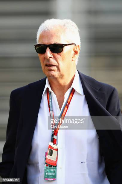 Marco Tronchetti the Chief Executive Officer of Pirelli walks in the Paddock before the Bahrain Formula One Grand Prix at Bahrain International...