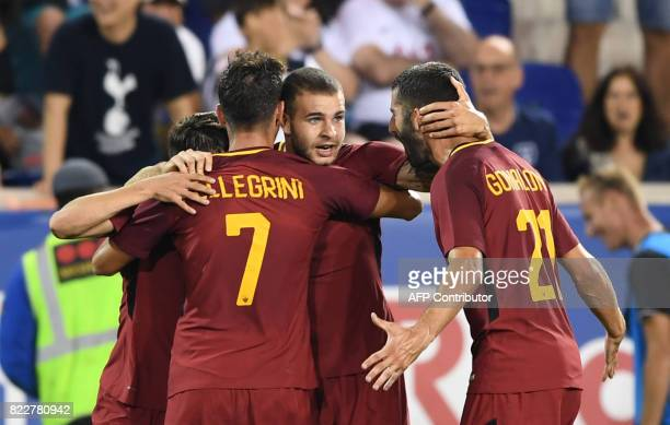 Marco Tumminello of AS Roma celebrates his goal with teammates Lorenzo Pellegrini and Maxime Gonalons during the International Champions Cup football...
