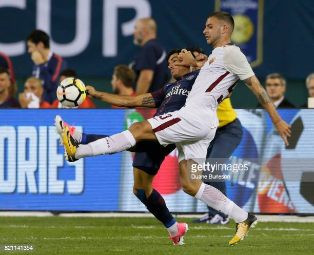 Marco Tumminello of AS Roma right pushes off on Yuri Berchiche of Paris SaintGermain while going after the ball during the second half at Comerica...