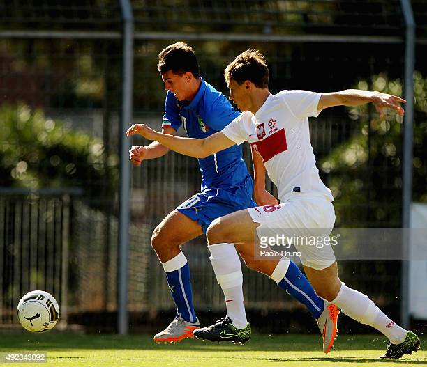 Marco Tumminello of Italy competes for the ball with Krystian Bielik of Poland during the international match between Italy U18 and Poland U18 on...