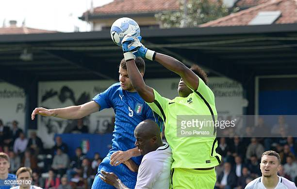 Marco Tumminello of Italy competes with Loic Badiashile goalkeeper of France during the U18 international friendly match between Italy and France at...