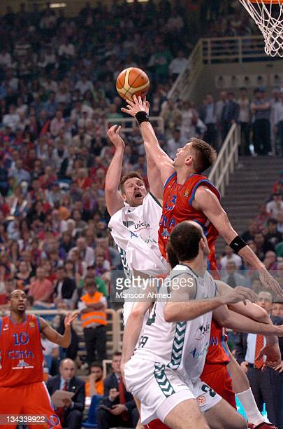 Marco Tusek of Unicaja Malaga sees his shot blocked by David Andersen of CSKA Moscow during the Euroleague Final Four Semi Final on May 4th 2007 at...