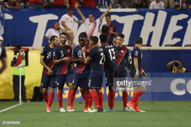 Marco Ureña of Costa Rica celebrates with teammates after scoring the first goal of his team during the Group A match between Honduras and Costa Rica...