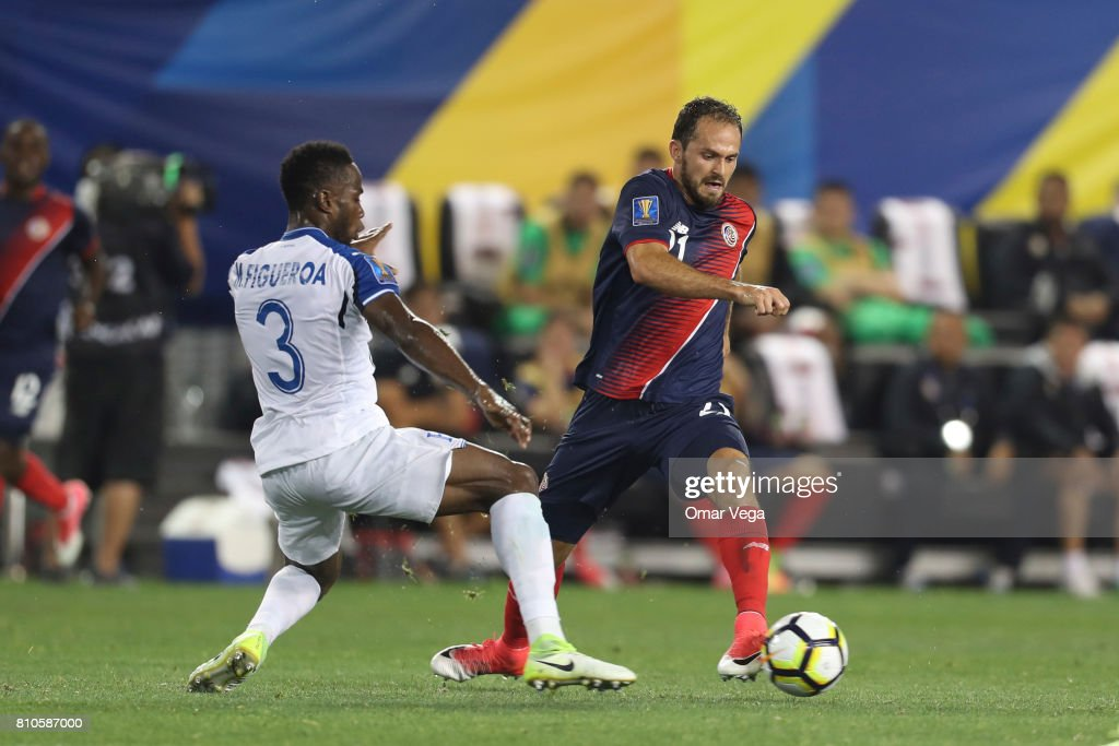 Marco Ureña of Costa Rica fights for the ball with Maynor Figueroa of Honduras during the Group A match between Honduras and Costa Rica as part of the Gold Cup 2017 at Red Bull Arena on July 07, 2017 in Harrison, New Jersey.