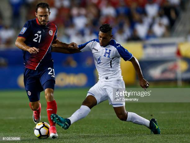 Marco Urena of Costa Rica fights for the ball with Bryan Acosta of Honduras during their CONCACAF Gold Cup match at Red Bull Arena on July 7 2017 in...