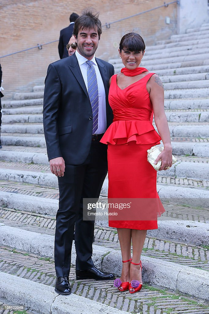 Marco Uzzo and Ana Laura Ribas attend the the Valeria Marini and Giovanni Cottone wedding at Ara Coeli on May 5, 2013 in Rome, Italy.