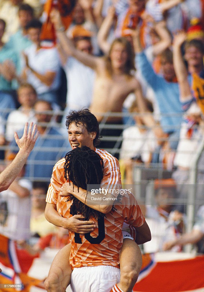 Marco Van Basten celebrates his hat trick goal with Ruud Gullitt during the 1988 European Championship match between England and Netherlands at the...