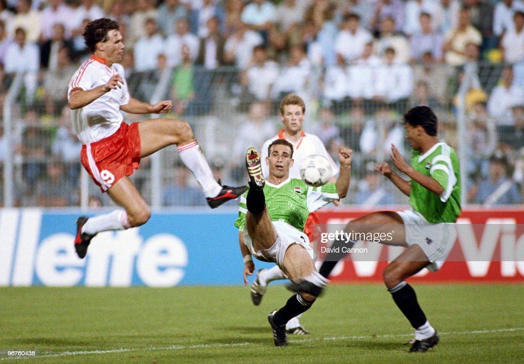 Marco Van Basten of the Netherlands challenges Hossam Hassan of Egypt during their Group F match of the 1990 FIFA World Cup on 12 June 1990 at the...