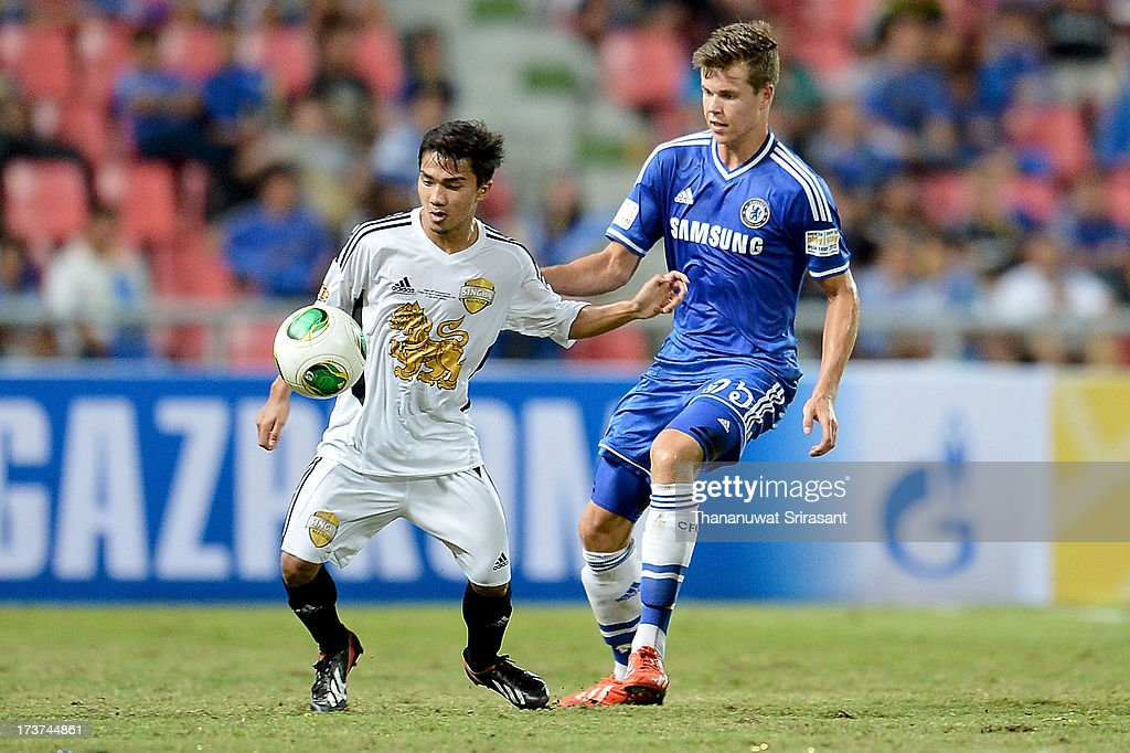 Marco van Ginkel of Chelsea FC with Chanathip Songkrasin of Singha All-Star during the international friendly match between Chelsea FC and the Singha Thailand All-Star XI on July 17, 2013 in Bangkok, Thailand.