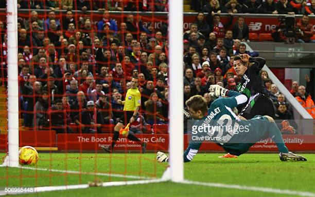 Marco van Ginkel of Stoke City shoots past goalkeeper Simon Mignolet of Liverpool but hits the post during the Capital One Cup semi final second leg...