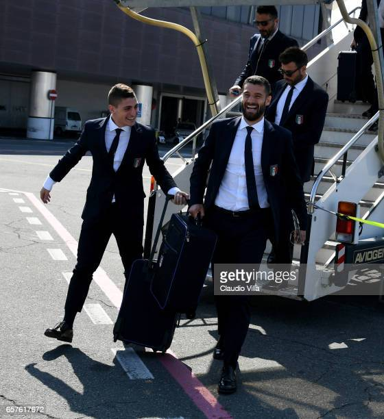 Marco Verratti and Antonio Candreva of Italy arrive to Florence Airport on March 25 2017 in Florence Italy