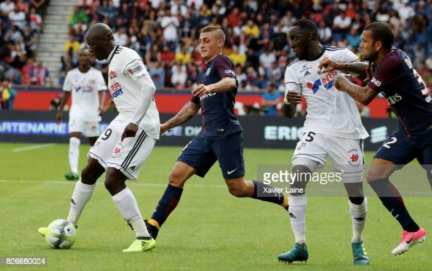 Marco Verratti and Daniel Alves of Paris SaintGermain in action with Seybou Koita of Amien SC during the French Ligue 1 match between Paris Saint...