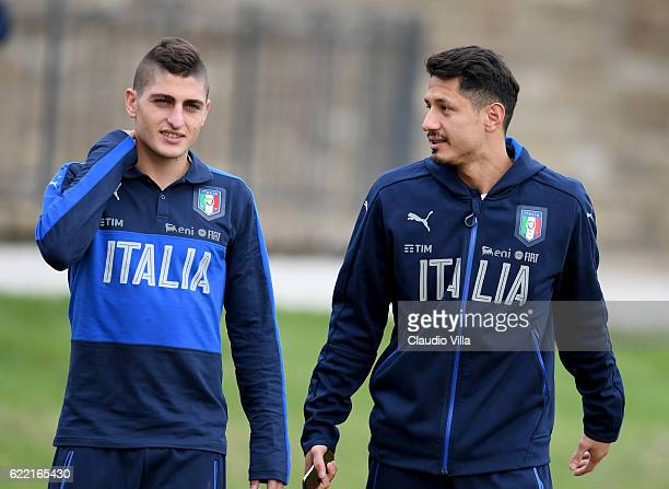 Marco Verratti and Gianluca Lapadula of Italy chat during the training session at the club's training ground at Coverciano on November 10 2016 in...