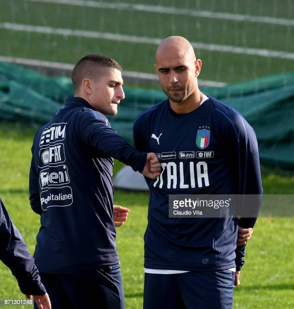 Marco Verratti and Simone Zaza of Italy are joking prior to the training session at Italy club's training ground at Coverciano on November 7 2017 in...