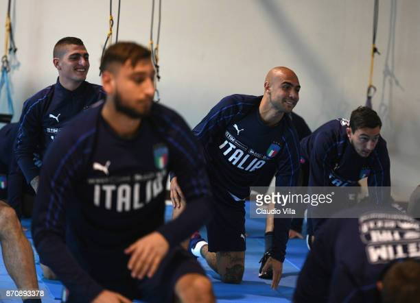 Marco Verratti and Simone Zaza of Italy chat during a training session at Italy club's training ground at Coverciano on November 6 2017 in Florence...